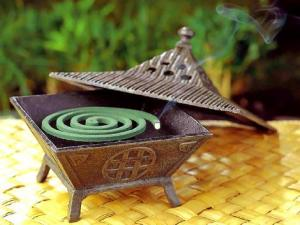 Mosquito coil and burner.