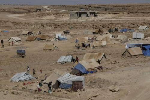 The northern side of a camp for displaced people in Amran. About 30 families are sharing a single water tank here.
